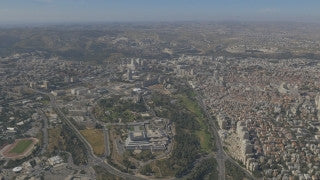 AJ4K_044 - Aerial 4K footage of Jerusalem: filming south to north: Knesset, government hill, givat Ram and north Jerusalem