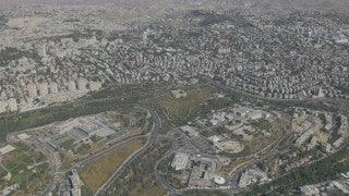 AJ4K_045 - Aerial 4K footage of Jerusalem: from the west - Givat Ram, the Israel Museum, The Knesset building and government Hill.
