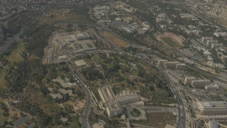AJ4K_048 - Aerial 4K footage of Jerusalem: Circling from the east - The Supreme Court, Givat Ram, the Israel Museum, The Knesset building and government Hill