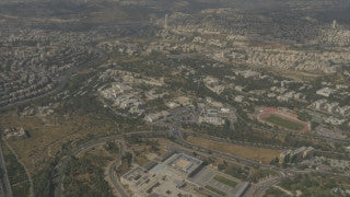 AJ4K_049 - Aerial 4K footage of Jerusalem: From the east - The Supreme Court, Givat Ram, the Israel Museum, The Knesset building.