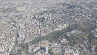 AJ4K_052 - Aerial 4K footage of Jerusalem: From the south: a high altitude shot of The Israel Museum in Jerusalem, Givat Ram, Knesset and Government Hill.