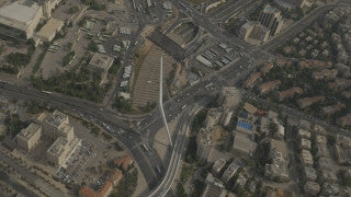 AJ4K_057 - Aerial 4K footage of Jerusalem: the city entrance: The Calatrava string bridge, central bus station and the western neighbothoods of Jerusalem.