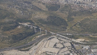 AJ4K_062 - Aerial 4K footage of Jerusalem: Route 1 and the new bridge in the western entrance to Jerusalem