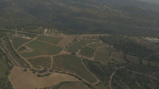 AJ4K_070 - Aerial 4K footage of Jerusalem: Fields and woods near Route 1 in the western slopes of the Judaean Hills