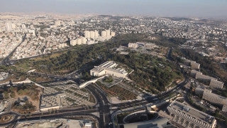 AJ_012E Aerial helicopter footage of Jerusalem - Knesset building and Government Hill