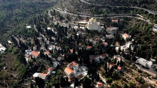 AJ_016E Aerial helicopter footage of Jerusalem - High angle Monastery and village of Ein Karem