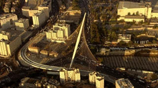 AJ_025n Aerial helicopter footage of Jerusalem city entrance, Calatrava String Bridge
