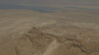 AM4K_003 4K Aerial Masada: Fly past Dead Sea in the background to Masada