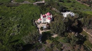 AN_011 Aerial helicopter footage of Northern Israel: Orthodox church in Capernaum and Sea of Galilee