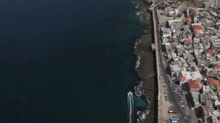 AN_017E Aerial helicopter footage of Northern Israel: Coast line of the Old City of Acre - Akko