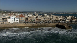 AN_022 Aerial helicopter footage of Northern Israel: the Old City of Acre and city wall from the sea
