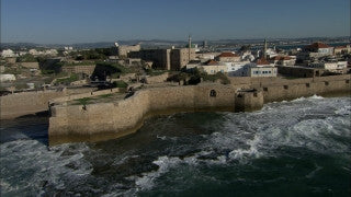 AN_023 Aerial helicopter footage of Northern Israel: the Old City of Acre and city wall from the sea