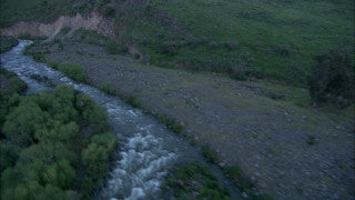 AN_046 Aerial helicopter footage of Northern Israel: Jordan River - flying along the river