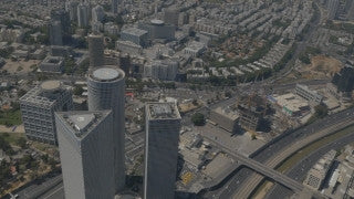 AT4K_001 Aerial 4K Tel Aviv: Circle Azrieli Towers, fly back to reveal skyline