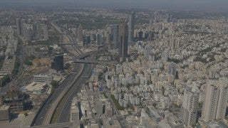AT4K_004 Aerial 4K Tel Aviv: Tel Aviv skyline, Azrieli towers, sea in background