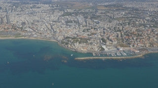 AT4K_020 Aerial 4K Tel Aviv: Old Jaffa and port with Tel Aviv in background, fly back