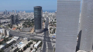AT_023E Aerial helicopter footage of Tel Aviv Jaffa Port and promenade at sunset