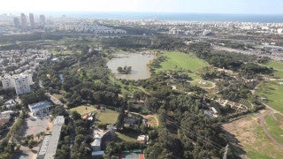 AT_003E Aerial helicopter footage of Tel Aviv, municipal park - Hayarkon Park and lake