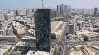 AT_027E Aerial helicopter footage of Tel Aviv city center high-rise buildings and Ayalon