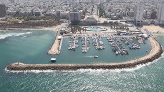 AT_012E Aerial helicopter footage of Tel Aviv sea shore and Marina