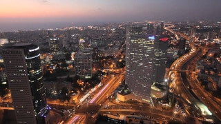 AT_015E Aerial helicopter footage of Tel Aviv skyline at sunset, Ayalon and Azrieli Towers