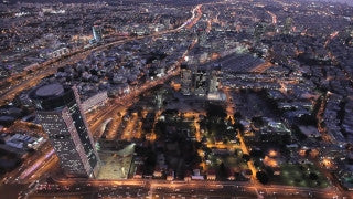 AT_018E Aerial helicopter footage of Tel Aviv Sarona and city center at night