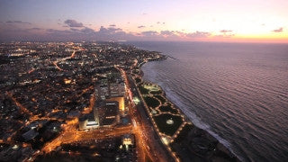 AT_020E Aerial helicopter footage of Tel Aviv sea shore and skyline at sunset