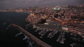 AT_021E Aerial helicopter footage of Tel Aviv Jaffa Port at sunset