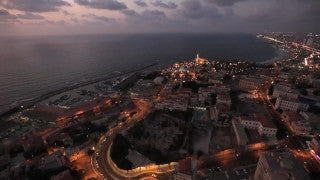 AT_022E Aerial helicopter footage of Tel Aviv Jaffa and Jaffa Port at sunset
