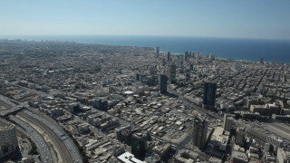 AT_031E Aerial helicopter footage of Tel Aviv high altitude east to west and sea shore
