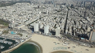 AT_032E Aerial helicopter footage of Tel Aviv hotels and sea shore