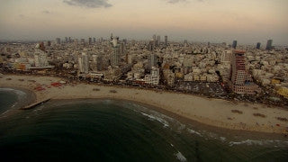 AT_033N Aerial helicopter footage of Tel Aviv: sea shore and hotels at sunset