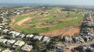 AT_043E Aerial helicopter footage of Central Israel - Caesarea residential areas and golf course