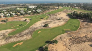 AT_044E Aerial helicopter footage of Central Israel - Caesarea residential areas and golf course