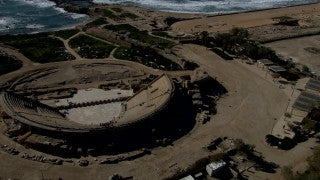 AT_047N Aerial helicopter footage of Central Israel: Caesarea Roman Theatre and coast line from east