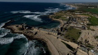 AT_049N Aerial helicopter footage of Central Israel: Caesarea Roman port and tourist site