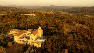 AT_052N Aerial helicopter footage of Central Israel: Latrun Trappists Monastery low altitude