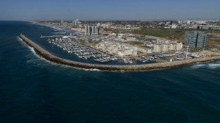 AT_057N Aerial helicopter footage of Central Israel: Herzliya Marina and coastline