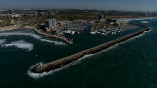 AT_058N Aerial helicopter footage of Central Israel: Herzliya Marina and coastline from the north