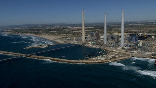 AT_061N Aerial helicopter footage of Central Israel: Hadera power plant and coastline