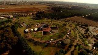 AT_064N Aerial helicopter footage of Central Israel: Ra'anana municipal park