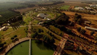 AT_065N Aerial helicopter footage of Central Israel: Ra'anana municipal park and lake