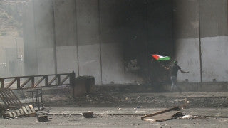 CJ_005 Jerusalem Conflict 2015: Palestinian clash with police: Smoke, Palestinians Waving Flag