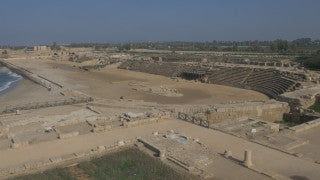 DC4K 002 G - 4K aerial drone footage pulling back from ancient Caesarea archaeological site