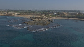 DC4K 007 G Aerial drone footage of the ancient Caesarea - approaching the Roman theater