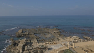 DC4K 006 G Aerial drone footage of the ancient Caesarea ancient harbor, flying west