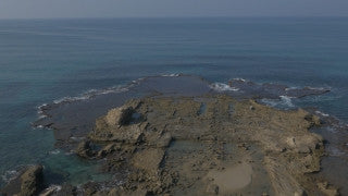 DC4K 010 G Aerial 4K drone footage of ancient Caesarea Maritima flying over the underwater harbor