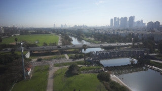 DC002B Aerial drone footage of Tel Aviv & Central Israel: Tel Aviv - Hayarkon Park with boats and birds