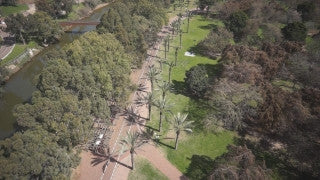 DC001B Aerial drone footage of Tel Aviv & Central Israel: Tel Aviv - Hayarkon Park with cityscape in background