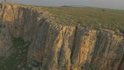 DN4K 008 G Israel stock footage: 4K drone aerial footage of Arbel cliff, slow climb of drone